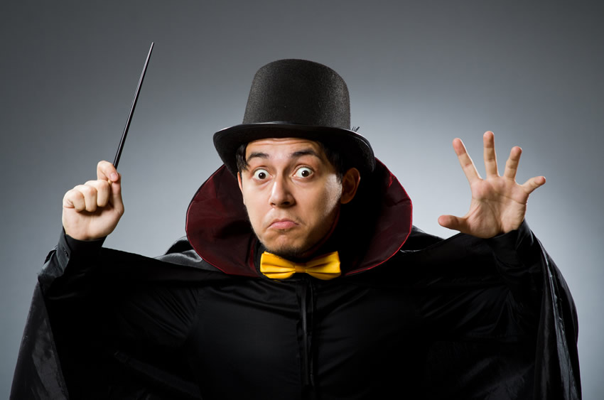 funny magician holding a magic wand. bankruptcy is not a magic wand